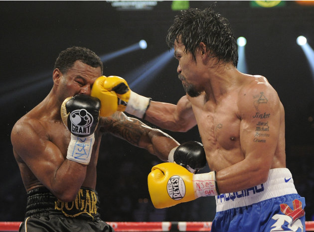 Manny Pacquiao, right, lands a punch against Shane Mosley in the ninth round during a WBO welterweight title bout, Saturday, May 7, 2011, in Las Vegas.  (AP Photo/Mark Terrill)