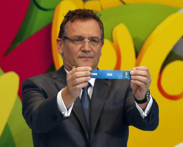 "FIFA Secretary General Jerome Valcke holds the slip showing ""United States"" during the draw for the 2014 World Cup at the Costa do Sauipe resort in Sao Joao da Mata"