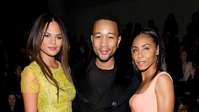 Model Chrissy Teigen, left, musician John Legend, and actress Jada Pinkett Smith attend the Fall 2013 Vera Wang Runway Show, on Tuesday, Feb. 12, 2013 in New York. (Photo by Dario Cantatore/Invision/AP)