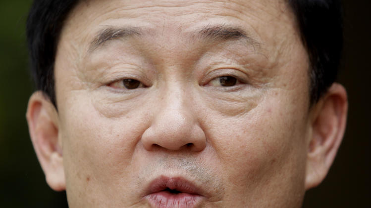 Fugitive former Thai Prime Minister Thaksin Shinawatra speaks to the journalists at his luxury villa in Dubai, United Arab Emirates, Monday July 4, 2011. (AP Photo/Kamran Jebreili)