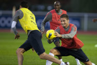 French forward Olivier Giroud, right, is seen during a training session at Clairefontaine training center, in Clairefontaine, west of Paris, Wednesday Nov. 9, 2011. France will play U.S. Nov. 11 in an international friendly soccer match. (AP Photo/Thibault Camus)