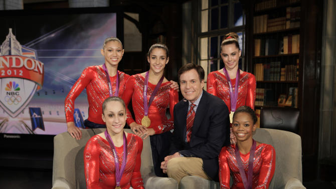 "This Tueday, July 31, 2012 photo released by NBC shows the US Women's Gymnastics team, winners of the gold medal for women's team gymnastics, Kyla Ross, standing left, Jordyn Wieber, seated left, Aly Raisman, standing center, McKayla Maroney, and Gabby Douglas, seated right, with NBC Sports' Bob Costas in London. NBC is set to ""break even"" on its Olympics coverage, rather than lose money as previously expected, the head of NBCUniversal said Wednesday, Aug. 1. The company had expected at one point to take a $200 million loss on the London Olympics. NBC paid $1.2 billion for the rights to show the games on TV and online in the U.S. It has said that it sold more than $1 billion in ads, breaking the record of $850 million set during the Beijing Olympics in 2008. (AP Photo/NBC, Paul Drinkwater)"
