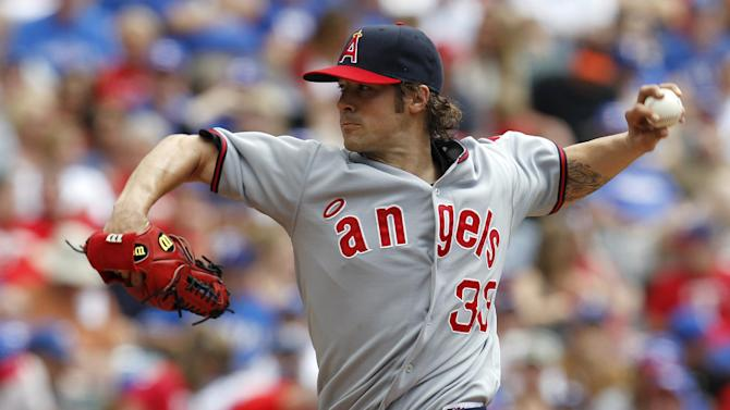 Los Angeles Angels starting pitcher C.J. Wilson (33) delivers to the Texas Rangers in the second inning of a baseball game Saturday, May 12, 2012, in Arlington, Texas. (AP Photo/Tony Gutierrez)