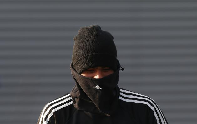 Chelsea's Ashley Cole walks to a training session at the team training facility in Stoke D'Abernon to the south of London