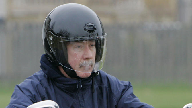 FILE - In this Nov 19, 2007 file photo, former Bolingbrook police officer Drew Peterson leaves his home on his motorcycle in Bolingbrook, Ill. Peterson was indicted in May 2009 on a murder charge in the death of his third wife, Kathleen Savio. Jury selection is scheduled to begin in his trial Monday, July 23, 2012. (AP Photo/M. Spencer Green, File)