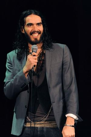 Russell Brand is all smiles while performing on stage at the Music Box at Borgata Hotel Casino and Spa in Atlantic City, N.J., on May 5, 2012 -- Borgata