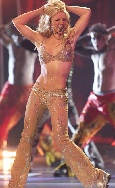"Behold, the original sparkly nude look! Britney Spears sizzled the rhinestones off her incredible body with an unbelievably sexy performance of ""Oops...I Did It Again"" at the 2000 MTV VMAs, proving on"