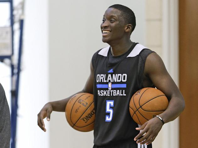 Orlando Magic's Victor Oladipo jokes with teammates at NBA basketball training camp, Tuesday, Oct. 1, 2013, in Orlando, Fla