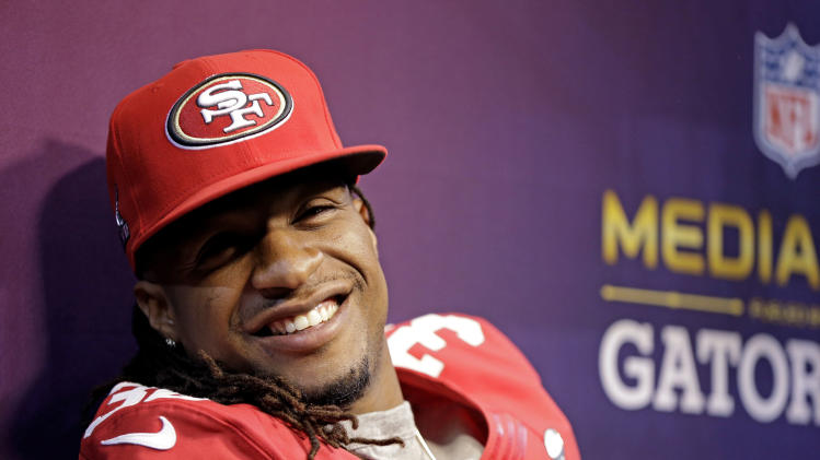 San Francisco 49ers safety Dashon Goldson (38) smiles during media day for the NFL Super Bowl XLVII football game Tuesday, Jan. 29, 2013, in New Orleans. (AP Photo/Mark Humphrey)