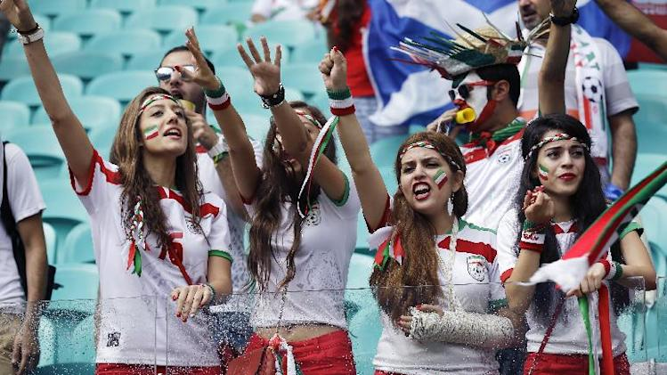 Iran's fans cheer for their team during the group F World Cup soccer match between Bosnia and Iran at the Arena Fonte Nova in Salvador, Brazil, Wednesday, June 25, 2014. (AP Photo/Martin Mejia)