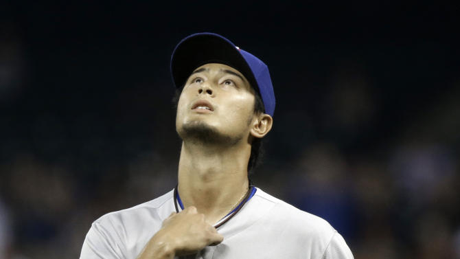 Texas Rangers starting pitcher Yu Darvish heads to the dugout at the end of the eighth inning of a baseball game against the Houston Astros on Tuesday, April 2, 2013, in Houston. Darvish pitched eight and two-thirds perfect innings before giving up a hit to Astros' Marwin Gonzalez in the Rangers' 7-0 win. (AP Photo/Pat Sullivan)