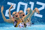 Russia&#39;s Natalia Ishchenko and Svetlana Romashina during their synchronised swimming duets final at the London Olympics on August 7. Russia won their fourth consecutive duets title on Tuesday after Ishchenko and Romashina&#39;s dazzling display earned gold with a final score of 197.100pts