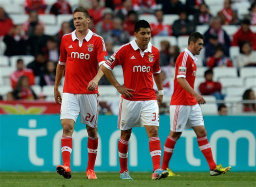 Benfica's Nemanja Matic, from Serbia, Enzo Perez, from Argentina, and Jardel Vieira, from Brazil, from left, react after Moreirense scored the opening goal during their Portuguese league last round so