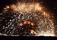 China ends Lunar New Year with molten metal showers
