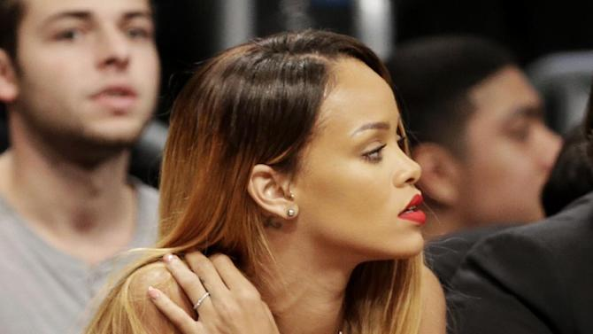Singer Rihanna watches Game 7 in a first-round NBA basketball playoff series between the Brooklyn Nets and the Chicago Bulls in New York, Saturday, May 4, 2013. (AP Photo/Julio Cortez)