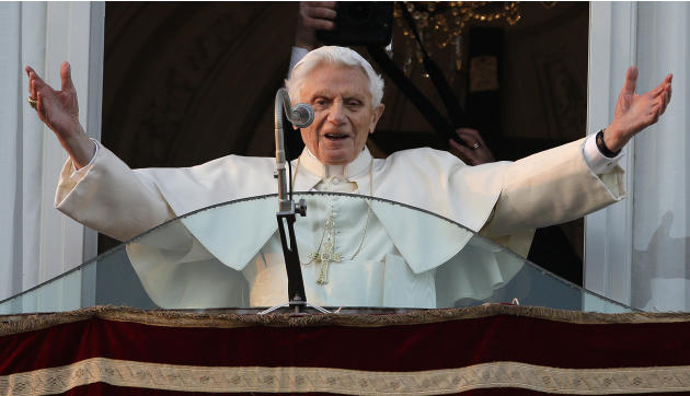 Pope Benedict XVI greets the crowd from the window of the Pope's summer residence of Castel Gandolfo, the scenic town where he will spend his first post-Vatican days and make his last public blessing