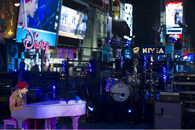 Justin Bieber performs in Times Square during New Year's Eve celebrations, Saturday, Dec. 31, 2011, in New York. (AP Photo/Charles Sykes)