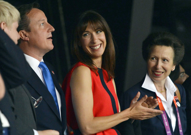British Prime Minister David Cameron, left, stands with his wife Samantha and Princess Anne after arriving for the Opening Ceremony of the 2012 Olympic Games on Friday, July 27, 2012, in London. (AP Photo/Toby Melville, Pool)