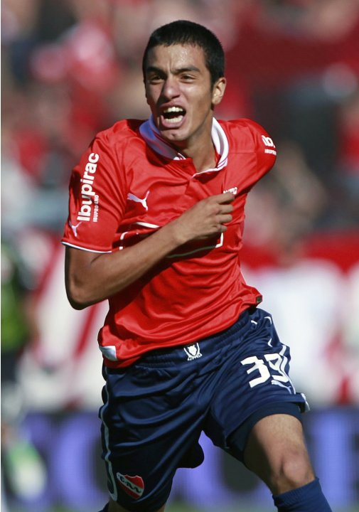 Independiente's Leonel Miranda celebrates after he scored a goal during their Argentine First Division soccer match against Racing Club in Buenos Aires