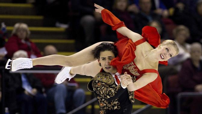 Canada's Kaitlyn Weaver and Andrew Poje perform during the ice dance short dance program during the 2014 Skate Canada International in Kelowna.