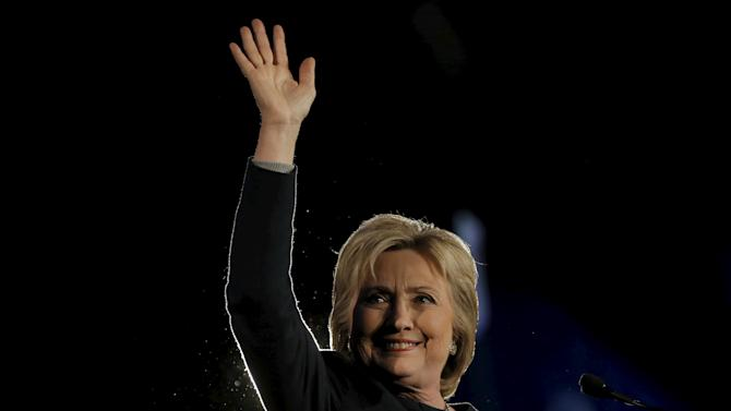 U.S. Democratic presidential candidate Hillary Clinton waves to the audience at the Jefferson-Jackson dinner in Denver