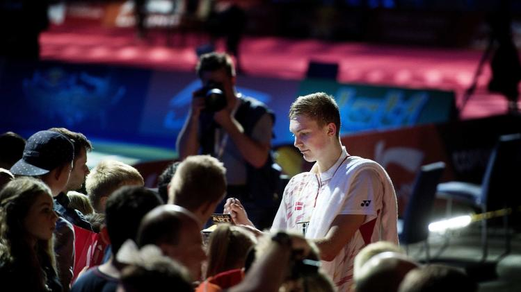 Viktor Axelsen of Denmark signs autographs after the men's singles semi-final match against Lee Chong Wei of Malaysia at the Badminton World Championships in Copenhagen