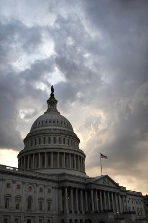 FILE - This Monday, Aug. 1, 2011 picture shows the U.S. Capitol just after the House voted to pass debt legislation on Capitol Hill in Washington. Credit rating agency Standard & Poor's says it has downgraded the United States' credit rating for the first time in the history of the ratings. The credit rating agency says that it is cutting the country's top AAA rating by one notch to AA-plus. The credit agency said late Friday, Aug. 5, 2011 that it is making the move because the deficit reduction plan passed by Congress on Tuesday did not go far enough to stabilize the country's debt situation. (AP Photo/Jacquelyn Martin)