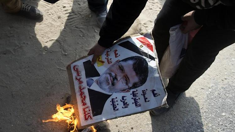 Egypt's Morsi urges 'revolution' as officer killed