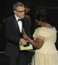 Actress Octavia Spencer, right, presents the award for best actor in a supporting role for &quot;Django Unchained&quot; to Christoph Waltz during the Oscars at the Dolby Theatre on Sunday Feb. 24, 2013, in Los Angeles. (Photo by Chris Pizzello/Invision/AP)