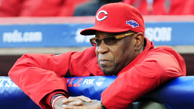 Cincinnati Reds manager Dusty Baker watches from the dugout in the first inning during Game 3 of the National League division baseball series against the San Francisco Giants, Tuesday, Oct. 9, 2012, in Cincinnati. (AP Photo/Al Behrman)