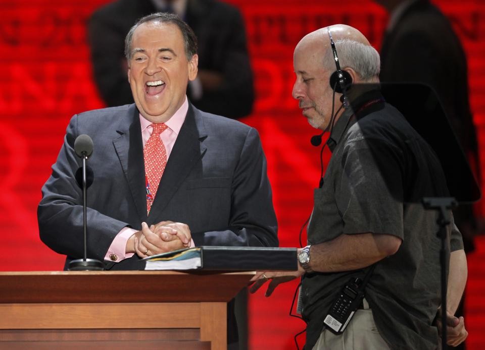 Former governor of Arkansas and conservative talk show host Mike Huckabee checks out the stage at the Republican National Convention inside the Tampa Bay Times Forum, Sunday, Aug. 26, 2012, in Tampa, Fla.  (AP Photo/Charles Dharapak)
