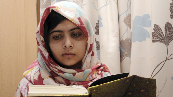 FILE - In this undated file photo provided by Queen Elizabeth Hospital in Birmingham, England, Malala Yousufzai, the 15-year-old girl who was shot at close range in the head by a Taliban gunman in Pakistan, reads a book as she continues her recovery at the hospital. Malala on Friday Feb 8 2013  has been discharged from a British hospital where she had been receiving treatment for nearly four months.(AP Photo/Queen Elizabeth Hospital, File)