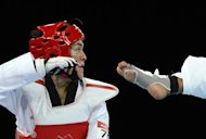 Mexico's Maria Del Rosario Espinoza Espinoza (red) fights against Cambodia's Davin Sorn during their women's taekwondo bout in the + 67 kg category as part of the London 2012 Olympic games, on August 11, 2012 at the ExCel centre in London. AFP PHOTO / TOSHIFUMI KITAMURA