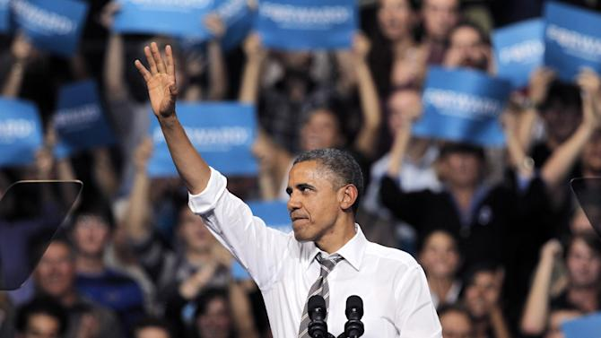 President Barack Obama waves after delivering a speech during a campaign rally at the University of Colorado, in Boulder, Colo., Thursday, Nov. 1, 2012. (AP Photo/Brennan Linsley)