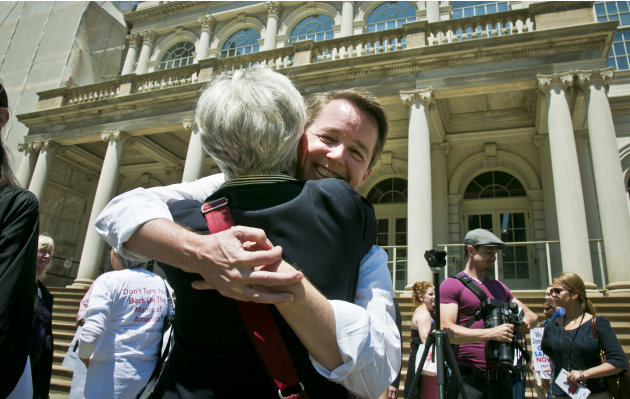 City council candidate Mel Wymore getsa hug  after a gun law rally on Friday, June 14, 2013 on the steps of New York City Hall. If Wymore wins a council seat it would mark the first transgender office