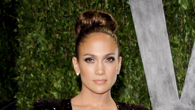 FILE - In this Feb. 26, 2012 file photo, actress and singer Jennifer Lopez arrives at the Vanity Fair Oscar party in West Hollywood, Calif. Lopez announced in a statement Monday, March 26, that she would be performing at the Pop Music Festival in Sao Paulo on June 23 and in Rio De Janeiro on June 27. (AP Photo/Evan Agostini, file)