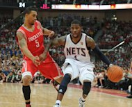 The Houston Rockets' Courtney Lee (left) and Nets' Terrence Williams compete during the Houston Rockets and New Jersey Nets game in the NBA China Games 2010 in Guangzhou. A group of Chinese academics has said English-language abbreviations such as NBA which have become part of everyday life in China should be struck from the country's top dictionary