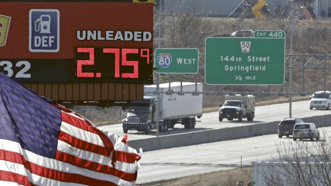 A sign advertising the price of gas towers over Interstate 80 in Omaha, Neb., Tuesday, Nov. 25, 2014. The cheapest gas in half a decade is expected to entice more Americans to pile into cars, trucks and vans for their Thanksgiving journeys. (AP Photo/Nati Harnik)