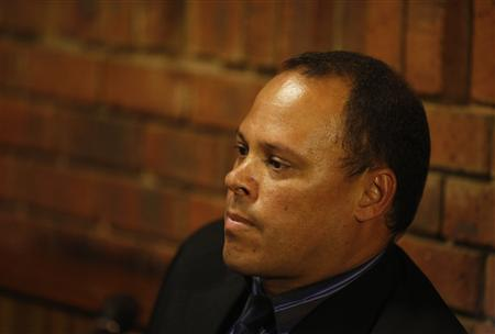 Investigating officer Botha, the lead detective in Pistorius murder case, sits in court during break in court proceedings at Pretoria Magistrates court