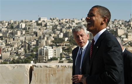 File photo of U.S. Democratic presidential candidate Senator Obama (D-IL) sharing a laugh with Senator Hagel (R-NE) at the Amman Citadel in Amman