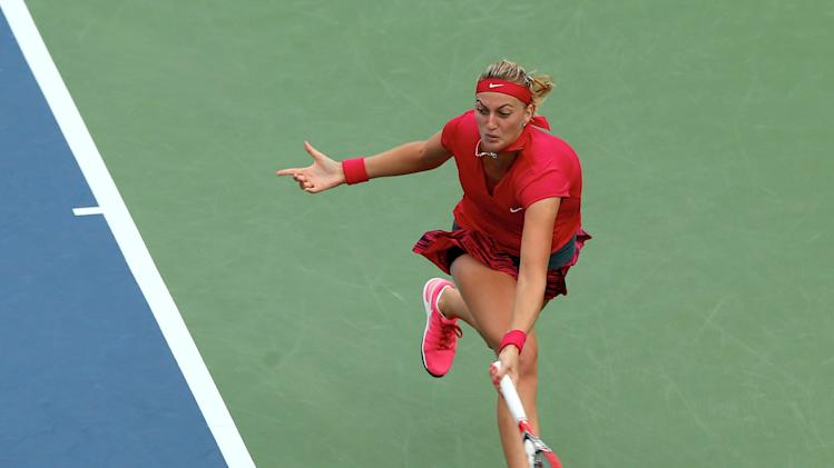 Petra Kvitova of the Czech Republic returns a shot to Magdalena Rybarikova of Slovakia during the women's final of the Connecticut Open on August 23, 2014
