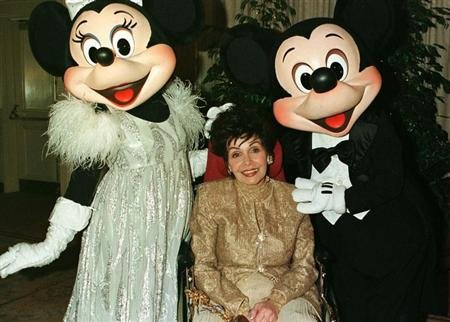 "Actress Annette Funicello poses with Disney characters ""Minnie Mouse "" (L) and ""Mickey Mouse"" during a VIP reception February 15, 1997 prior to a benefit dinner hosted by the charity organization ""Women in Show Business...for children"", which honored the actress. Funicello, best known as a member of the ""Mickey Mouse Club,"" suffers from multiple sclerosis."