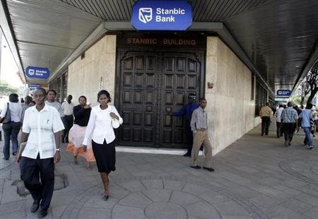 Kenyan city residents walk past Stanbic Bank in the capital Nairobi