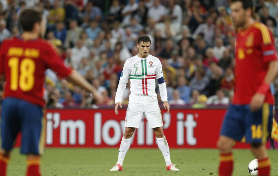 Portugal's Cristiano Ronaldo gets ready to perform a free kick, during the Euro 2012 soccer championship semifinal match between Spain and Portugal in Donetsk, Ukraine, Wednesday, June 27, 2012. (AP Photo/Jon Super)