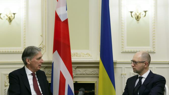British Foreign Secretary Hammond talks to Ukraine's Prime Minister Yatseniuk during their meeting in Kiev