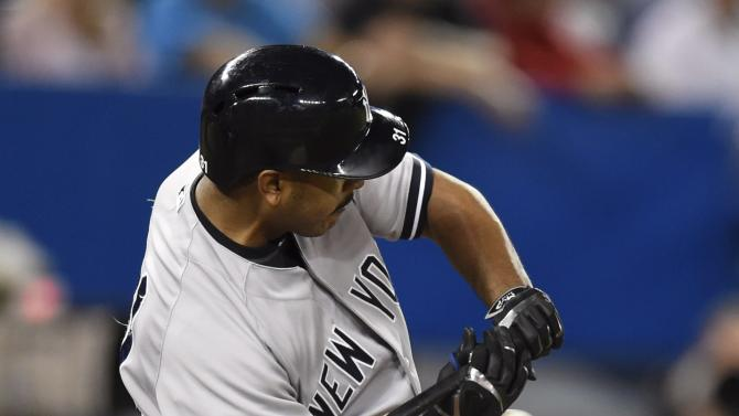 New York Yankees' Gregorio Petit is hit by a pitch from Toronto Blue Jays' Chad Jenkins during the eighth inning of a baseball game Tuesday, May 5, 2015, in Toronto. (AP Photo/The Canadian Press, Frank Gunn)