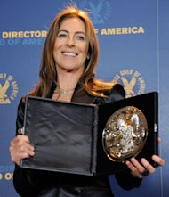 Kathryn Bigelow poses backstage with her feature film nomination plaque for &quot;Zero Dark Thirty&quot; at the 65th Annual Directors Guild of America Awards at the Ray Dolby Ballroom on Saturday, Feb. 2, 2013, in Los Angeles. (Photo by Chris Pizzello/Invision/AP)