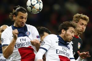 Paris St Germain's Ibrahimovic and Maxwell and Bayer Leverkusen's Kiessling jump for the ball during their Champions League soccer match in Leverkusen