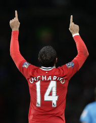 Manchester United's Javier Hernandez celebrates after scoring against Newcastle during their English Premier League soccer match at Old Trafford Stadium, Manchester, England, Saturday Nov. 26, 2011. (AP Photo/Jon Super)