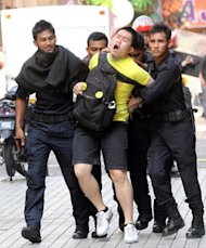Malaysian police drag away a protestor during an anti-government rally in Kuala Lumpur in April 2012. Malaysia's Sedition Act is to be repealed and replaced with the National Harmony Act. The new act will safeguard the right to freedom of speech while protecting national unity by preventing the incitement of religious or ethnic hatred